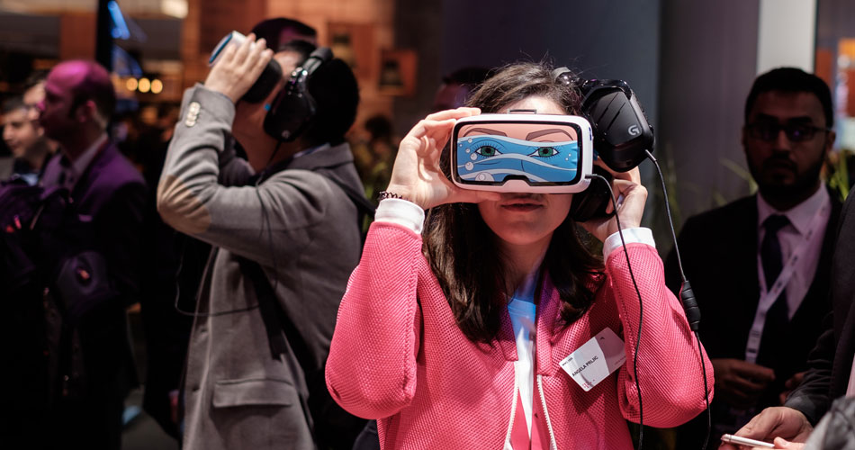 Users testing a virtual reality device at the Mobile World Congress